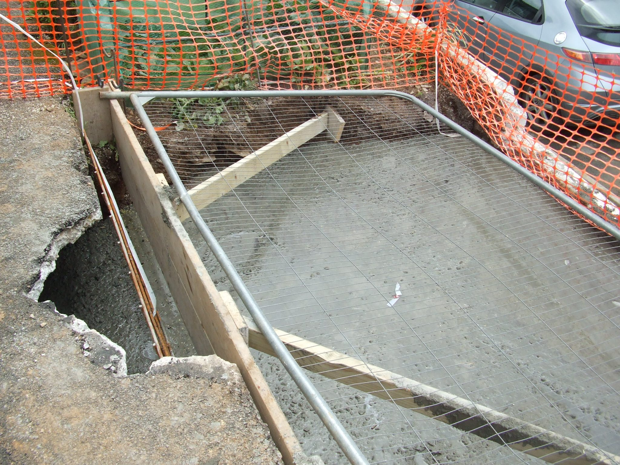 Hole filled with concrete.